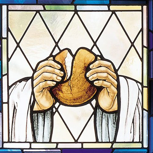 Stained Glass Window of A Man Breaking Bread